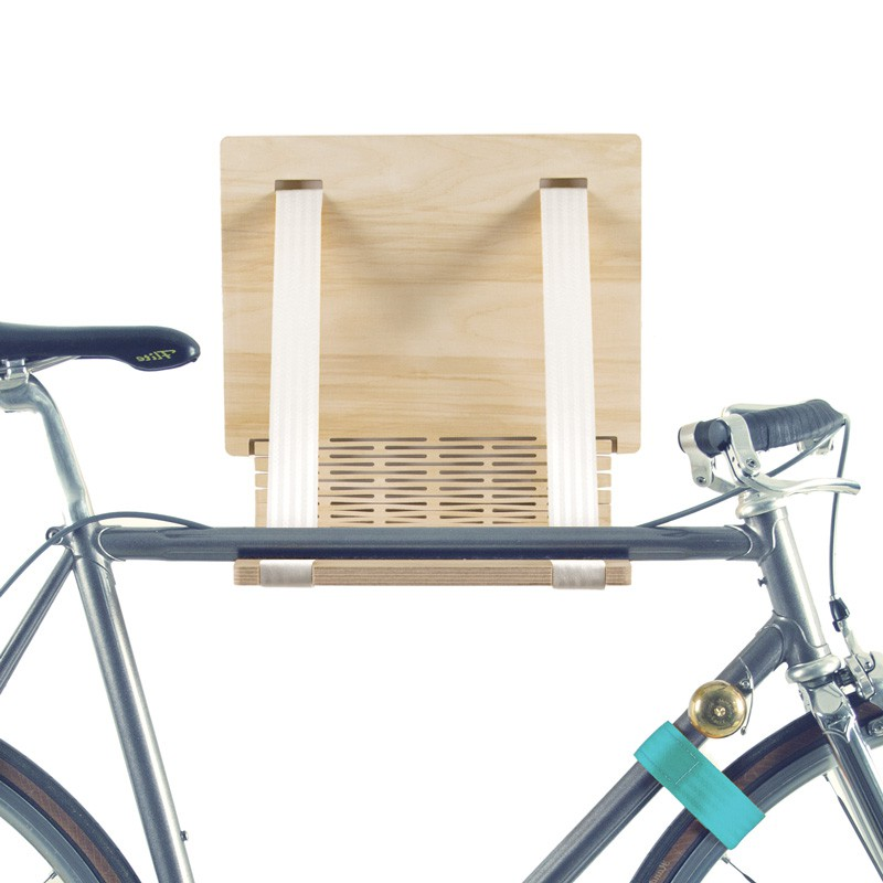 Wooden wall-mounted bike rack with white belts